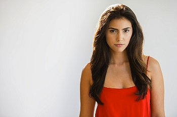 Serious woman in red